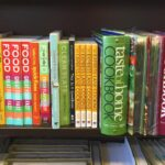A bookshelf filled with cookbooks