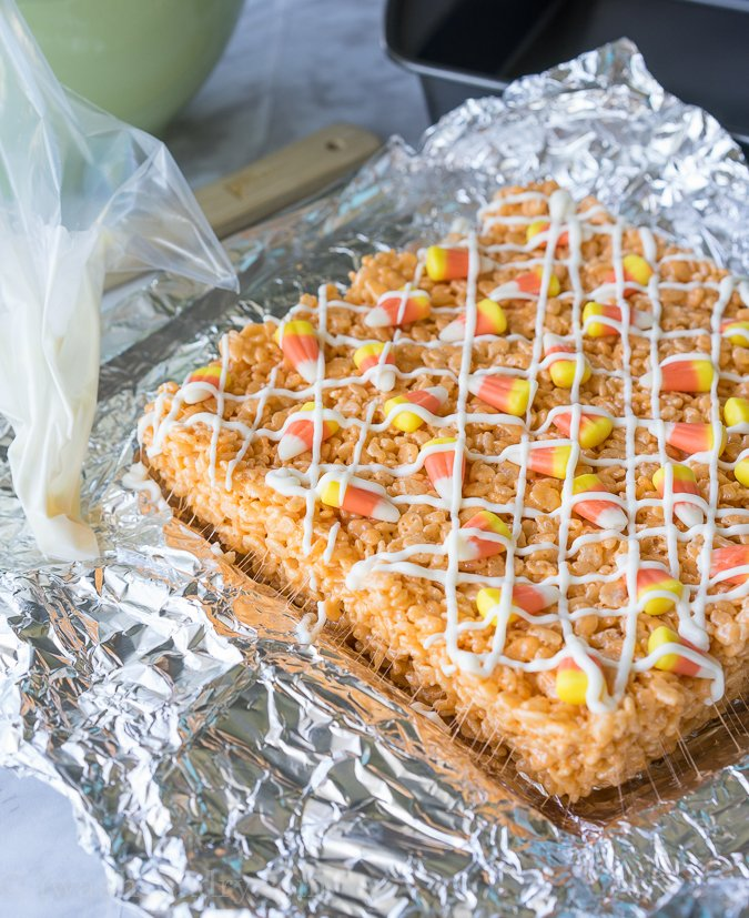 I have never had such a soft and chewy rice krispie treat until I made these glorious Candy Corn Rice Krispies Treats. This is the best recipe!