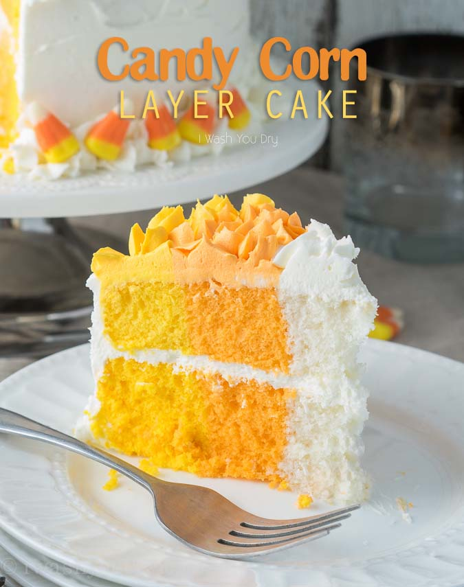 A slice of cake on a plate with yellow, orange and white layers