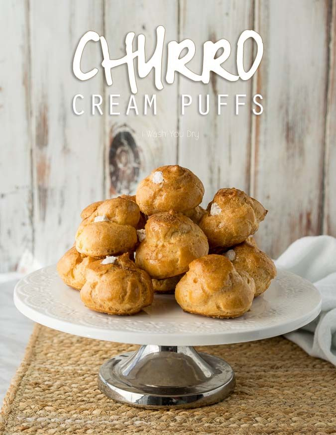 I never knew making homemade cream puffs was so easy! These Churro Cream Puffs are brushed with honey and dusted with cinnamon and sugar. The filling is a delightful cinnamon flavored whipped cream!