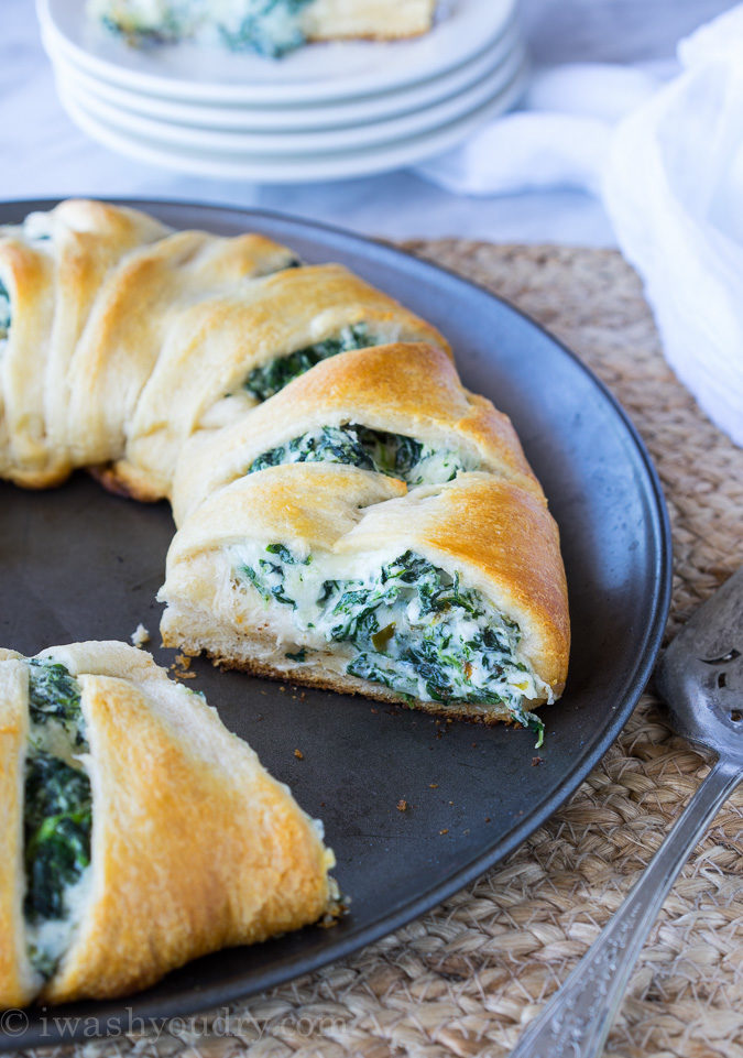 This Cheesy Spinach Jalapeño Crescent Ring is loaded with cream cheese, monterey jack cheese, spinach and diced pickled jalapeños. It's so easy to make and EVERYONE loves it!