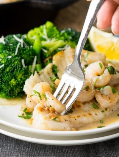 This quick and easy Skillet Tilapia with Shrimp is made in just one skillet and have an outrageously good white wine lemon pan sauce! My whole family loved this!