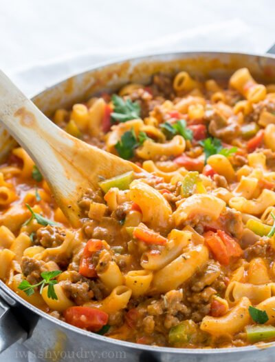 This Cheesy Sausage and Macaroni Skillet dinner recipe is super quick and easy, perfect for busy weeknights!