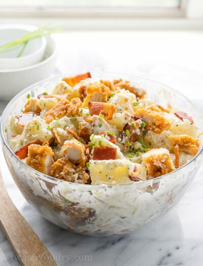This Chicken Bacon Ranch Potato Salad is full of crispy chicken, bacon and creamy ranch dressing! Everyone loves this simple salad!