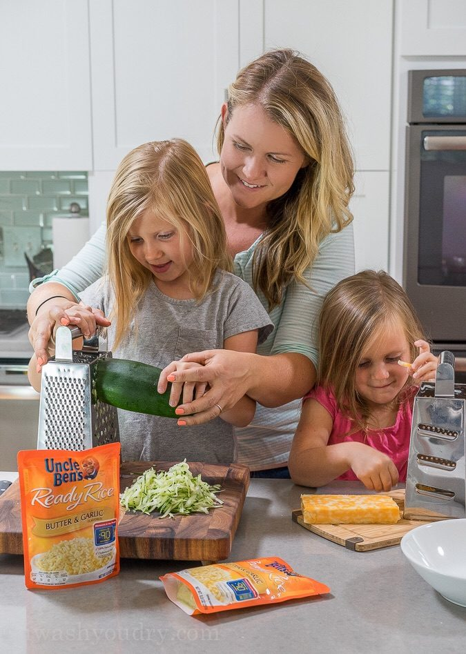 I love making this 5 minute Cheesy Zucchini Rice recipe for a quick and easy side dish! Even my kids get in there and help too!
