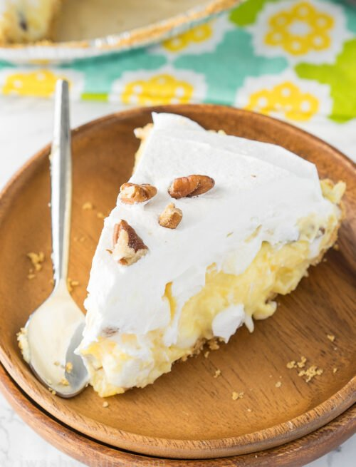 This Pineapple Fluff Pie takes all the goodness of the classic pineapple fluff and puts it into a super easy, no-bake, pie!