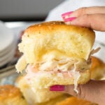 These Buttery Chicken Cordon Bleu Sliders have layers of swiss cheese, thinly sliced deli ham and chicken with an irresistible honey mustard sauce on buttery soft roll, then baked till hot and extra gooey.