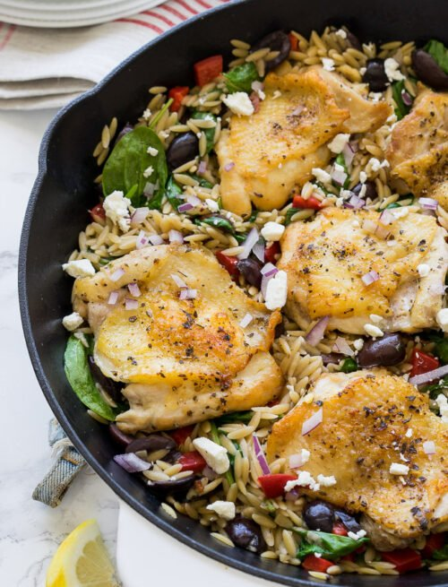 This Greek Chicken Skillet is a one pan meal that's full of bold flavors and made super quick! You'll love this recipe!