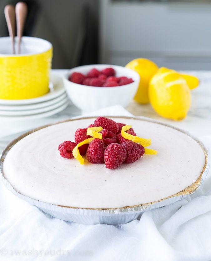 Frozen pie with raspberries and lemon swirls