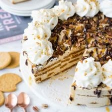 This no bake Gingersnap Turtle Icebox Cake is loaded with a sweet and creamy molasses filling, crisp gingersnap cookies and a hot fudge and caramel topping that's to die for!