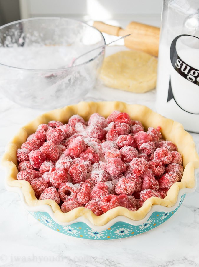 This homemade Raspberry Pie recipe is perfection! The filling is sweet and stays together, doesn't fall apart