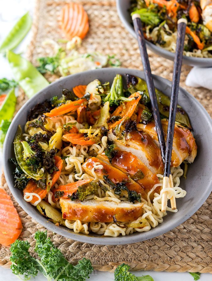 These super quick Roasted Orange Chicken Ramen Bowls are ready in less than 30 minutes! Filled with loads of veggies, plump and tender chicken all over a bed of hot noodles and drizzled with a tasty orange sauce!