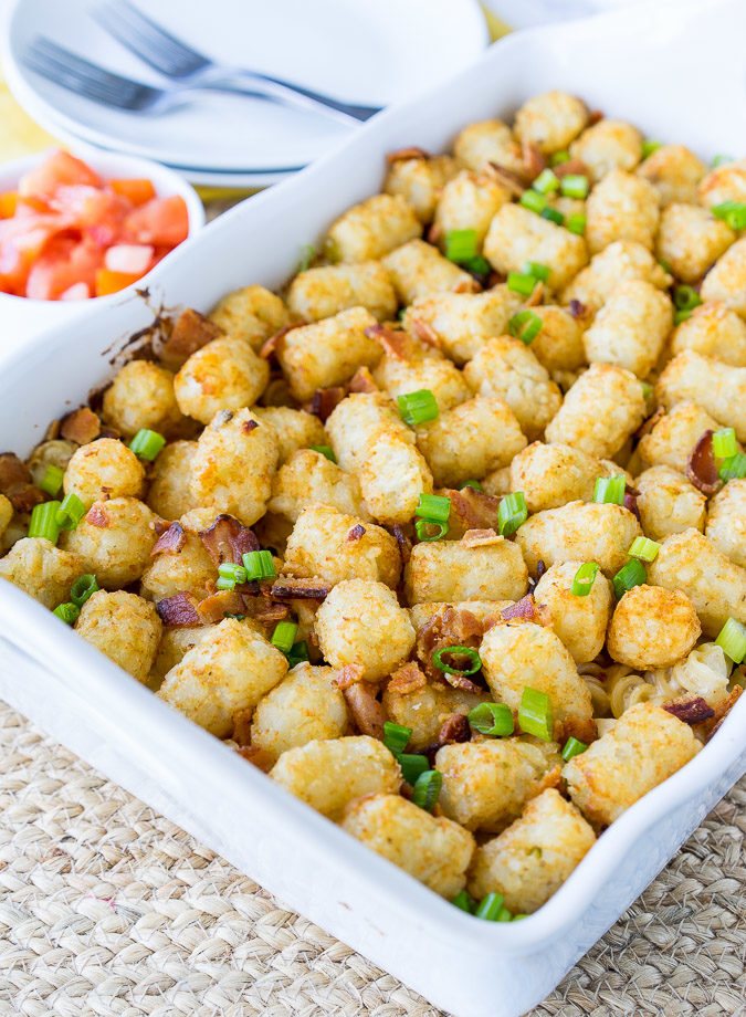 This Ultimate Chicken Bacon Ranch Casserole is filled with creamy pasta and topped with crispy tater tots! This is truly a family favorite where there are never any leftovers!