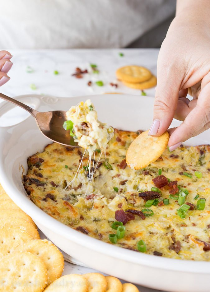 This Cheesy Bacon Artichoke Dip is just 5 ingredients and so easy to make! There are never any leftovers!