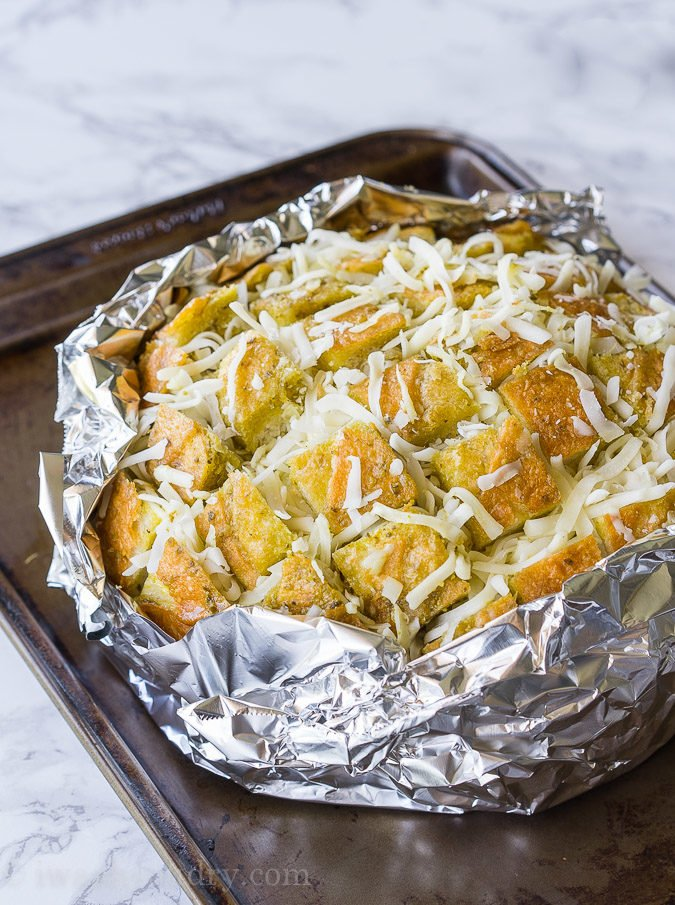 This Cheesy Pesto Crack Bread is a super quick and easy appetizer that everyone will go nuts for!