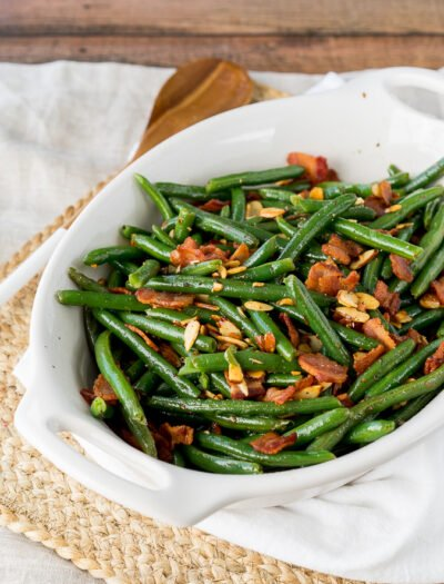 These Southern Green Beans with Bacon and Almonds are a side dish recipe that's a staple at any holiday dinner! Full of flavor and super easy to make, my whole family loves these!