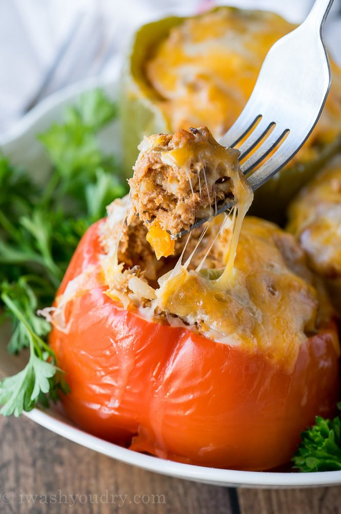 These Slow Cooker Steakhouse Stuffed Peppers are bursting with flavor and only take a few minutes to prep! The perfect easy weeknight dinner recipe!