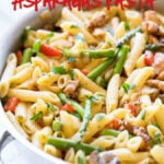 This Creamy Chicken Asparagus Penne Pasta is filled with fresh veggies and tender pasta in a light and creamy sauce! Another easy weeknight dinner recipe!
