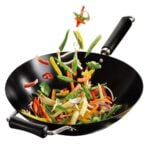 A wok with veggies in