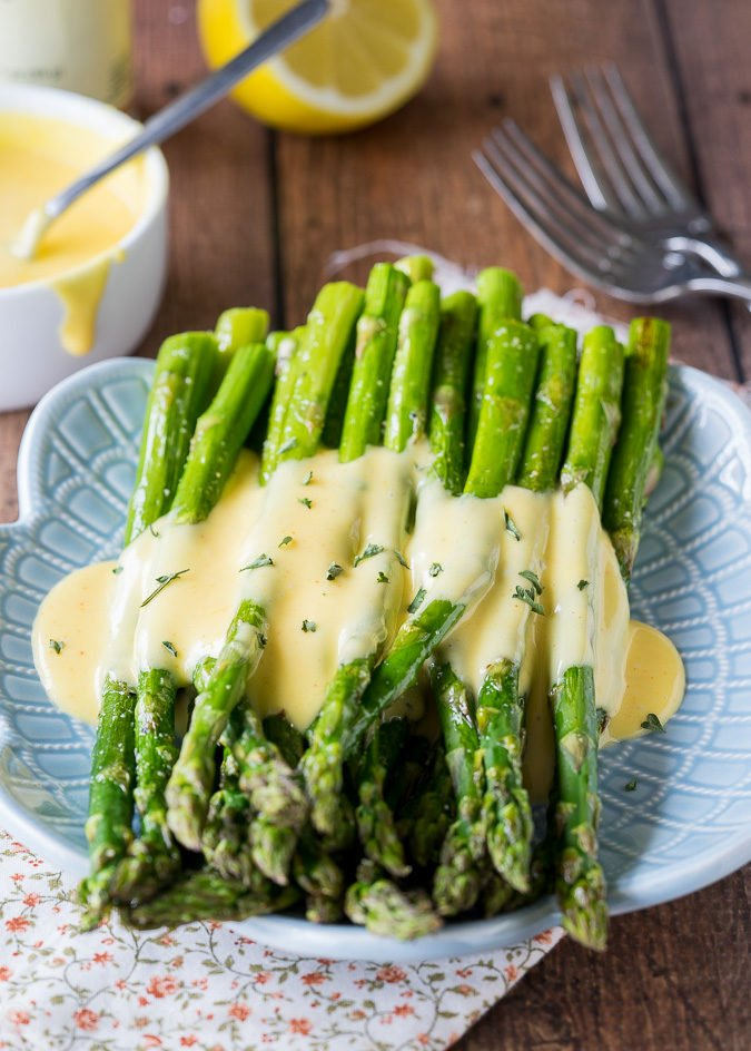 Oh my gosh! Ever since I've made this Easy Blender Hollandaise Sauce Roasted Asparagus, I can not stop thinking about it! It's so easy and turns an ordinary meal into something fancy and delicious!