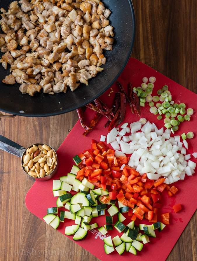 ingredients for kung pao chicken and veggies on cutting board