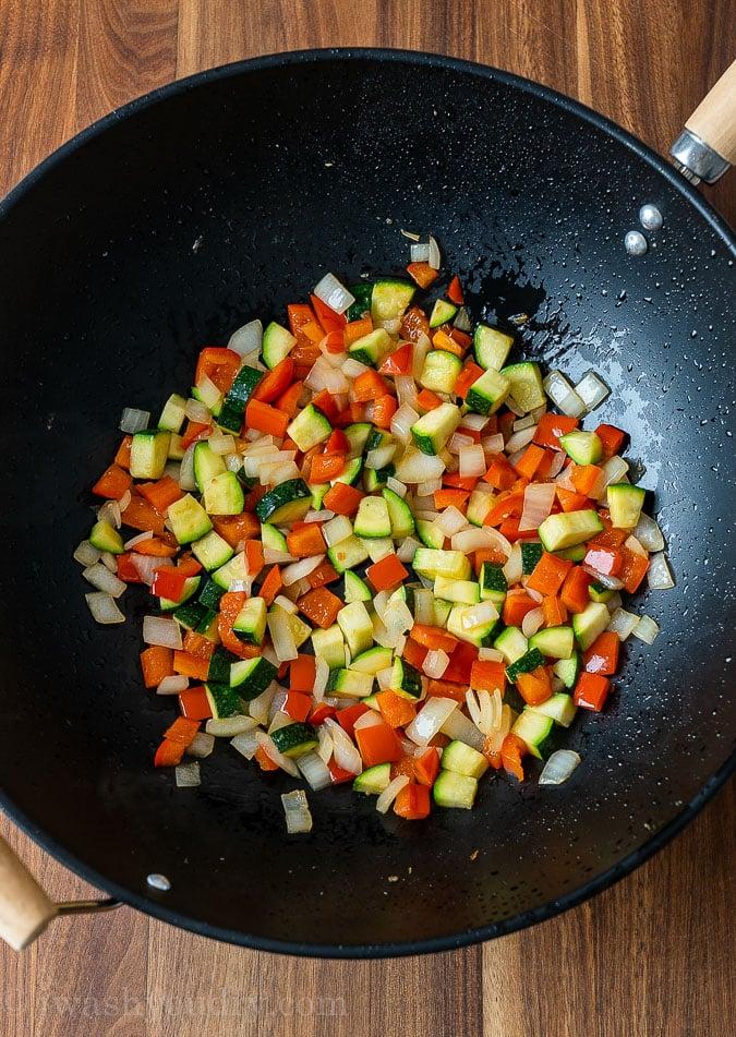 sautéed veggies in black wok