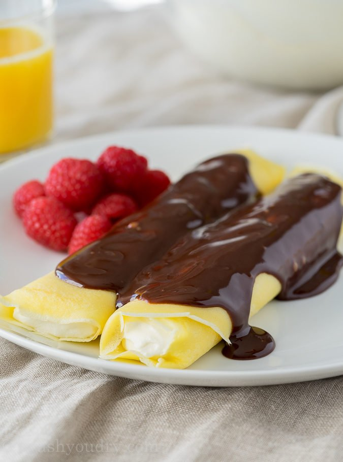 These Boston Cream Pie Crepes are filled with a light and fluffy cream filling and topped with a silky chocolate ganache! My whole family loved this super easy breakfast!