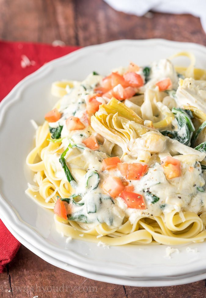 WOW! My whole family LOVED this Spinach Artichoke Fettuccine Alfredo! I mixed the sauce and noodles together and baked the leftovers with mozzarella on top! So good!