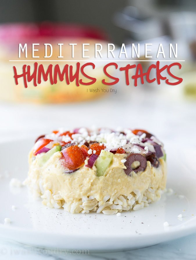 These Mediterranean Hummus Stacks are so much fun! They're filled with a simple Greek salad, classic @Sabra hummus and tender brown rice. We love serving these with a bowl of veggie chips!