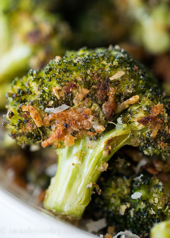 This Parmesan Roasted Broccoli is my new favorite way to eat broccoli! It's so simple and seriously so addictive! It's definitely a delicious baked broccoli recipe!