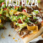 My family absolutely loves this Super Easy Taco Pizza! It's an easy recipe that my kids beg for!