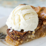 This Classic Pecan Pie Recipe is so easy to make! Just mix everything in a bowl and pour into a pie crust!