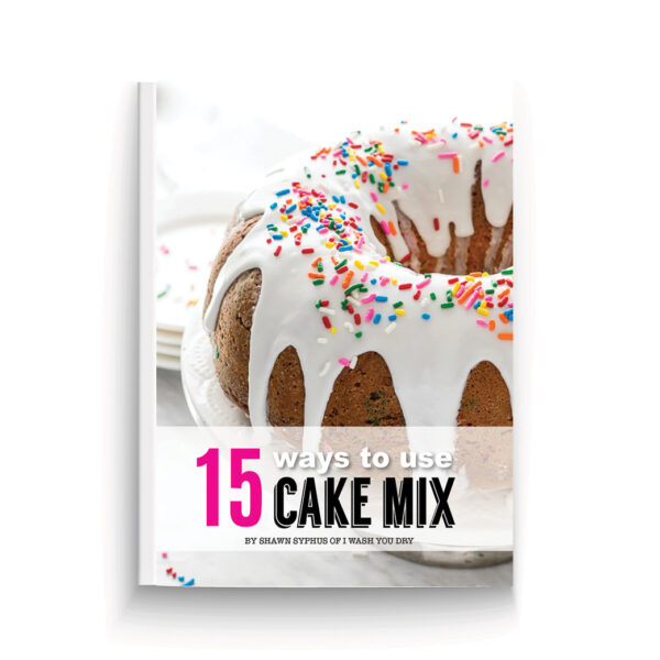 book cover picture with a cake on a table with white frosting and colorful sprinkles