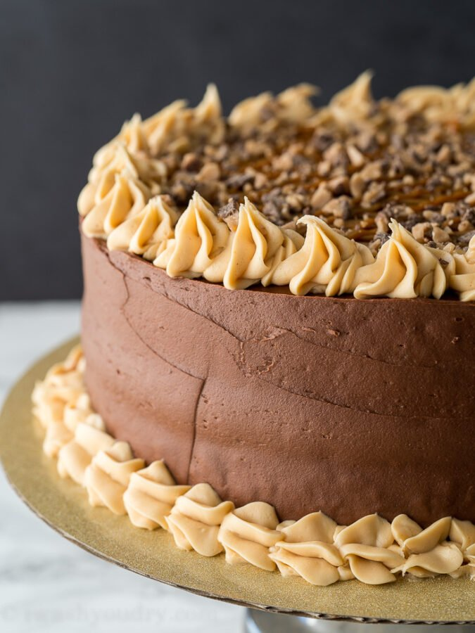 This decadent Chocolate Dulce de Leche Cake is filled with caramel and topped with toffee bits!