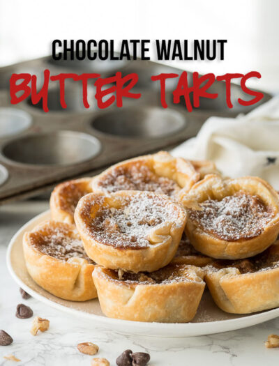 Many tarts stacked on a plate, with chocolate and walnut