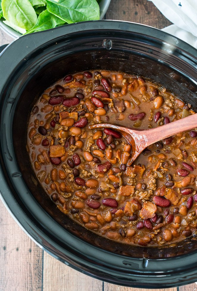 These Slow Cooker Steakhouse Cowboy Beans are a thick and hearty side dish with a punch of savory and sweet spices!