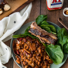These Slow Cooker Cowboy Beans are simmered all day for a deep intense flavor!