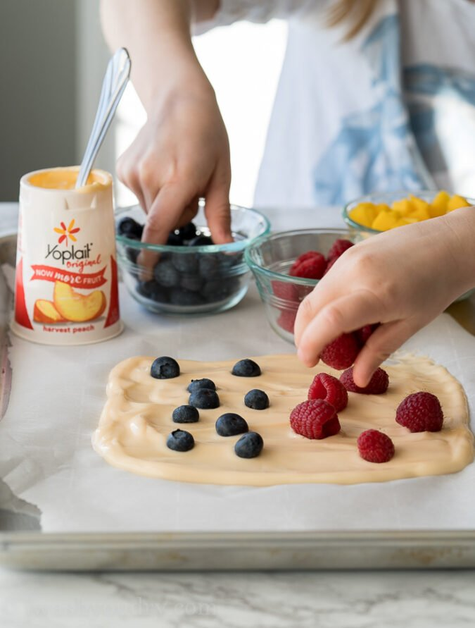 My kids are always so eager to help make recipes, and this super easy Frozen Yogurt Bark was the perfect treat for them to help with!