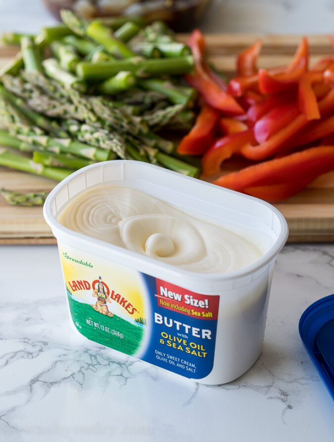 The perfect way to start any stir fry is with Land O Lakes spreadable butter with olive oil and sea salt!