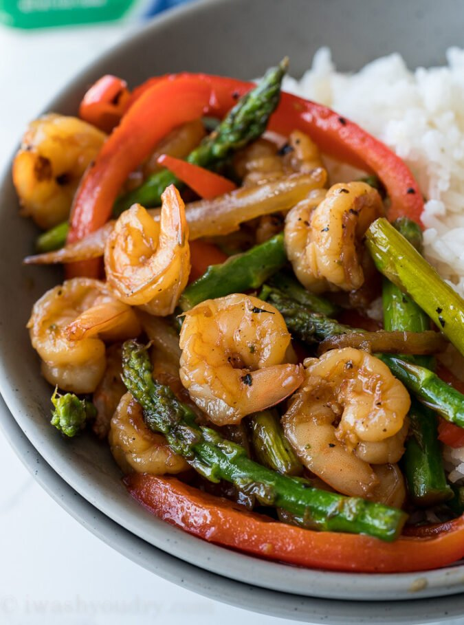 This quick and easy Honey Garlic Shrimp Stir Fry is filled with plump shrimp and fresh veggies in a simple and delicious honey garlic sauce!