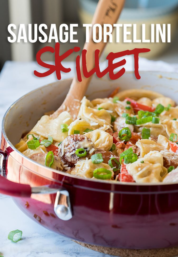 OMG! This Creamy Sausage Tortellini Skillet is a super quick weeknight dinner recipe that my whole family loves! It's on our weekly dinner menu now!