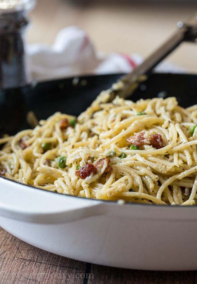 Toss the tender spaghetti in with the bacon and peas for an easy weeknight dinner!