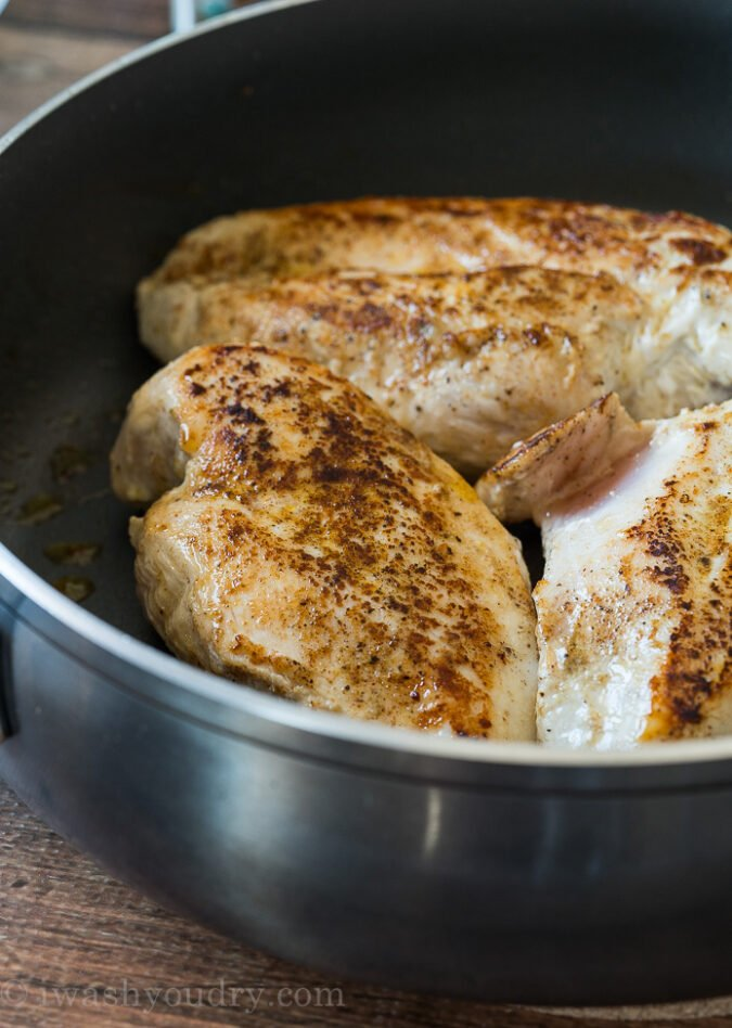 Season three large chicken breasts and sear in a large skillet until browned on each side.