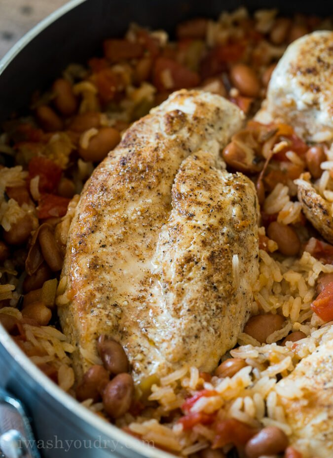 Once you add in the rice, salsa and chicken broth, place the chicken breasts back in, bring to a boil and then cover.