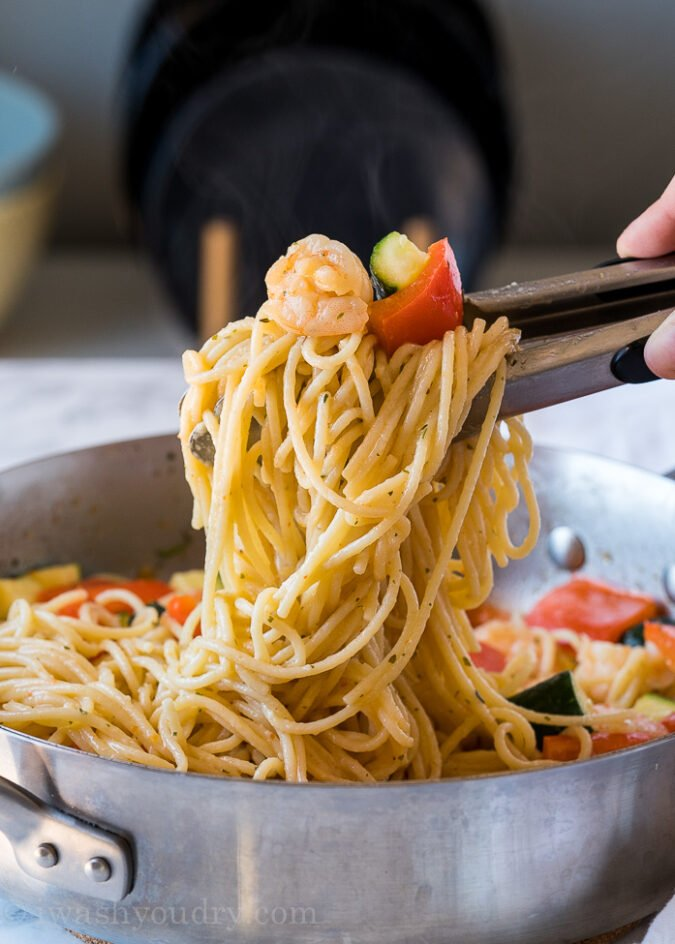 Toss in cooked pasta with the shrimp scampi, zucchini and bell peppers and dinner is ready!