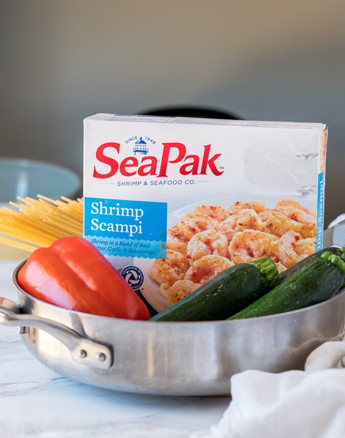 All you need to make this easy seafood dinner recipe is a box of frozen shrimp scampi from SeaPak, some zucchini, bell pepper and pasta!