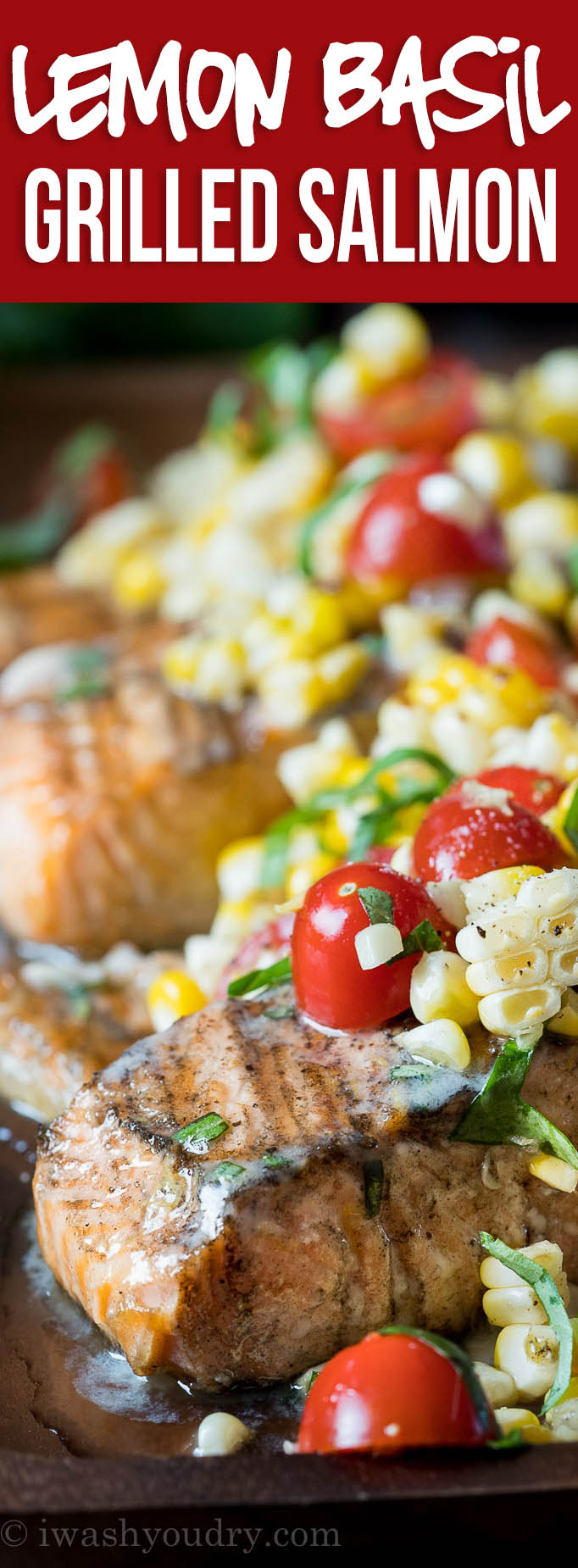 This Lemon Basil Grilled Salmon is topped with a lemon and basil infused butter and a grilled corn and tomato salad that's so fresh and delicious!