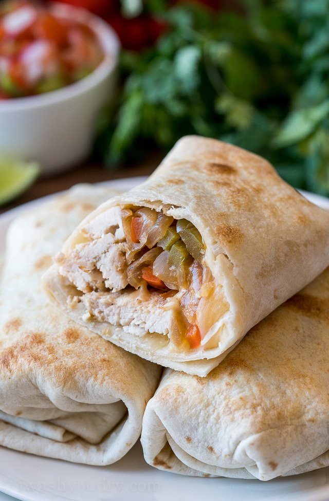 YUM! My kids LOVE these super easy Baked Chicken Fajita Burritos! It's all the goodness of fajitas wrapped up in a crisp tortilla!