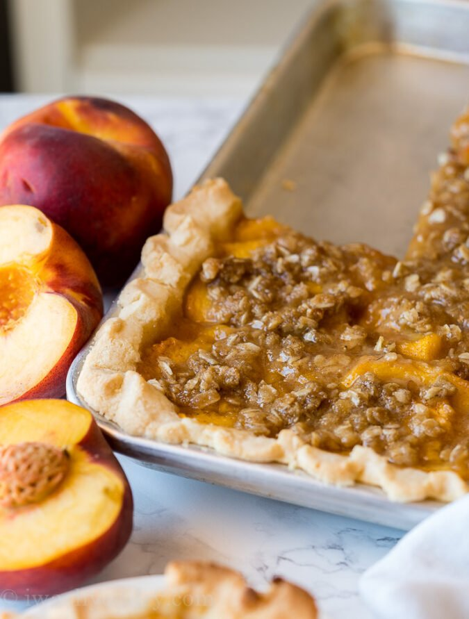 This Peach Slab Pie recipe is the perfect dessert for potlucks since it can easily serve a crowd!