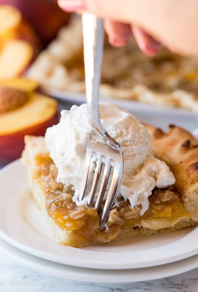 This Peach Slab Pie is filled with fresh peaches and topped with a crisp oat topping!